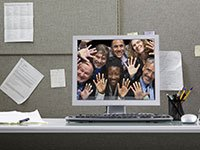 Business people inside a in computer monitor pressing their faces against the screen while smiling, Work Re-imagined