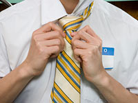 Man adjusting necktie