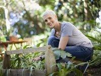 Woman gardening in backyard