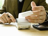 Calculating Expenses Using Adding Machine, Financing Your Start Up Business