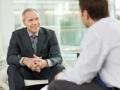 Two businessmen talking together