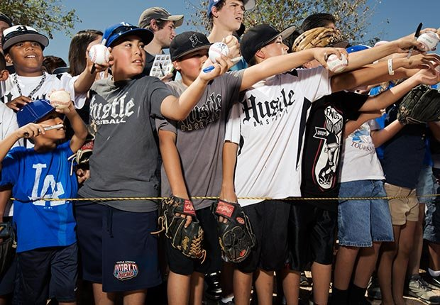 Young Dodger's fans clamor to get autographs.