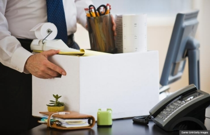 Businessman packing up office supplies. What you need to know when you've been laid off. (Daniel Grill/Getty Images)