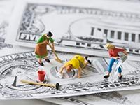 minimum wage salary federal fair labor laws dollar bill money cleaning ladies (Corbis)