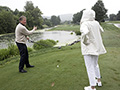 Pro golfer Michael Allen gives Jane Pauley some tips about golf at the En-Joie Golf Course in Endicott, New York