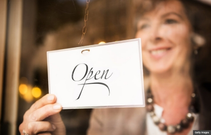 new career after retirement woman open sign shop