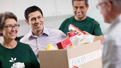 Volunteers collecting food donations. Jobs in demand in nonprofit sector.