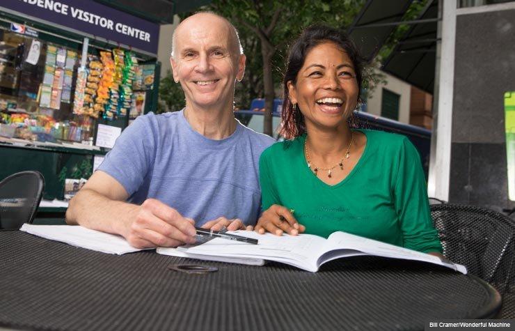 Robert Groves tutors Bekha Maya Maharjan in reading English, Encore Careers (Bill Cramer/Wonderful Machine)