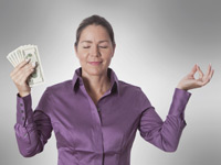 Woman meditating holding money, Stay calm during stock market turmoil