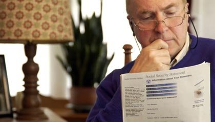 Senior man reading form, Questions and Answers on Social Security