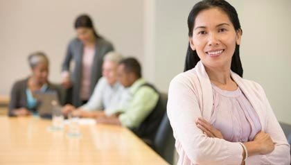 Woman in conference room, Social Security helping people to return to work. (Terry Vine/Blend Images/Corbis)