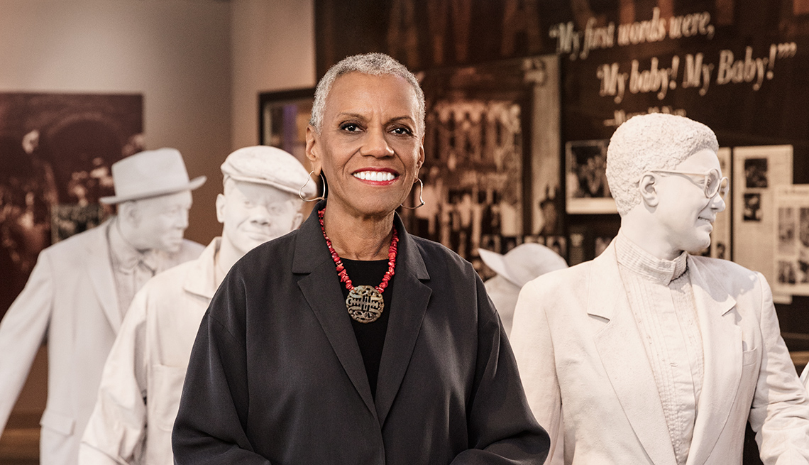 Andrea L. Taylor, CEO of the Birmingham Civil Rights Institute, in front of a museum exhibit