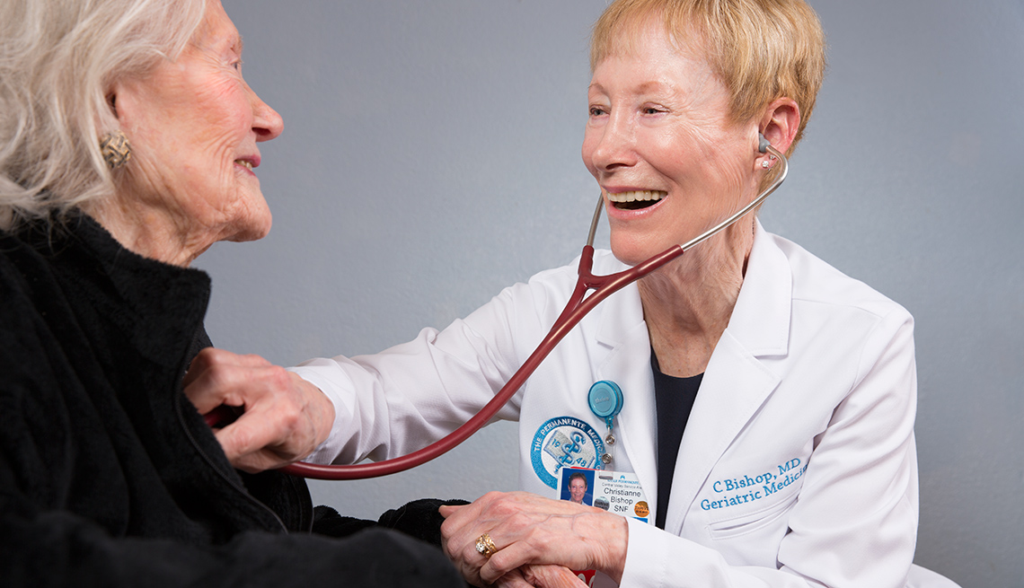 Geriatrician and Physician Christianne Bishop examines a female patient with a stethoscope