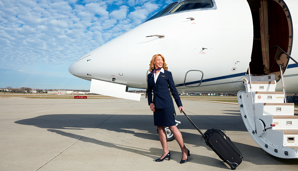 Flight Attendant Venetia Clark disembarks a plane