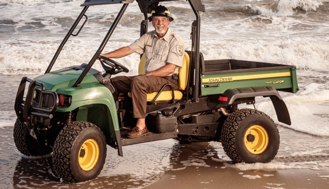 Park Ranger Dale Klco patrols at Hobe Sound in an ATV