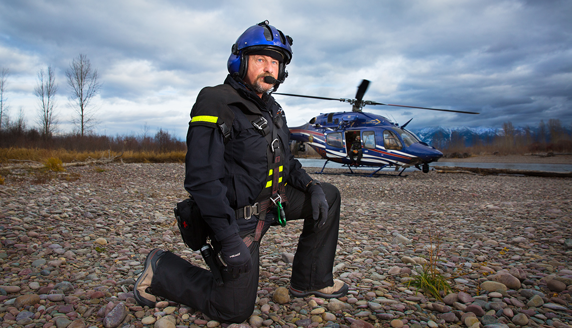 Glacier National Park Air Rescue specialist Dick Sine, in front of a helicopter
