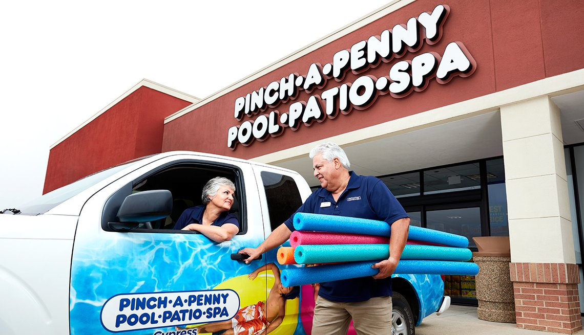 Maria Vidal-Escobar and Miguel Escobar talk in front of their pool and patio franchise store