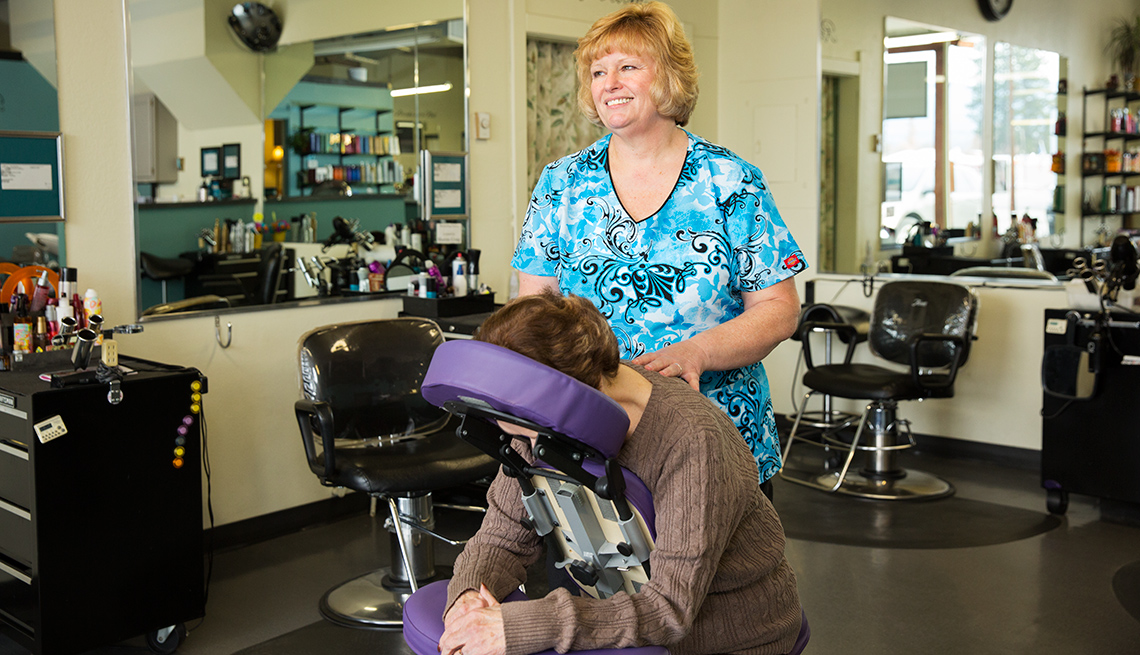 Massage therapist Julie MacDonald massages a patient's upper back