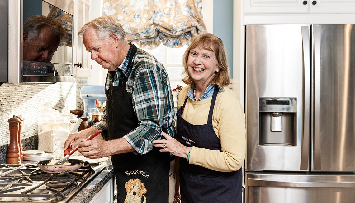 Innkeepers Bill and Linda Perry, cooking in their kitchen