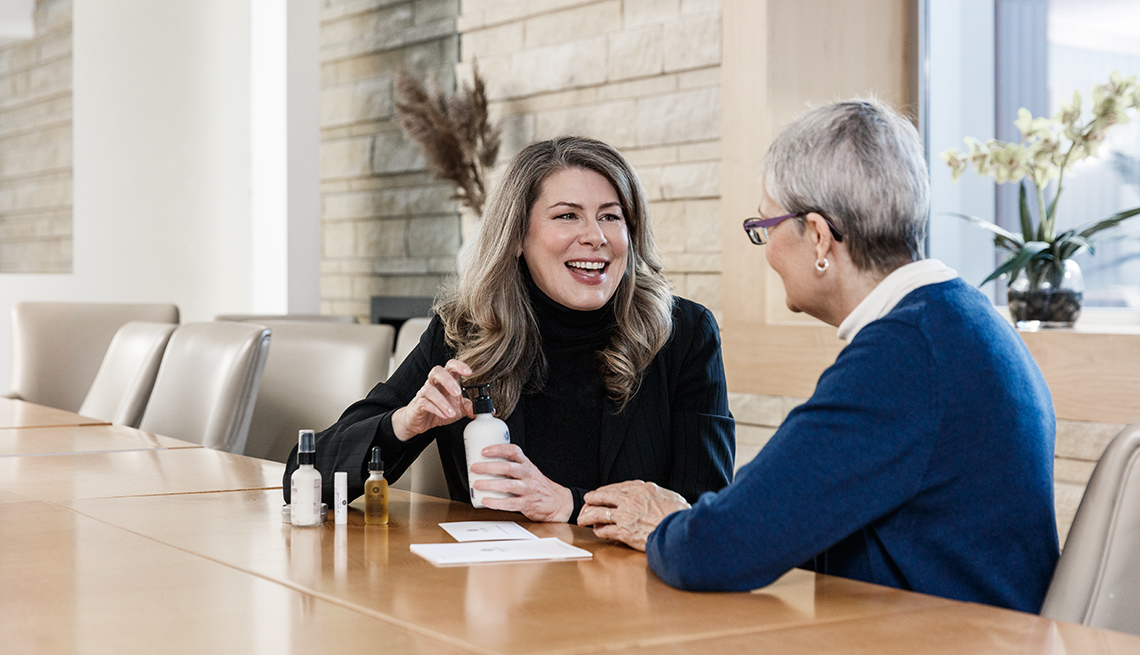 Skincare Entrepreneur Cynthia Besteman shows off her products in a meeting
