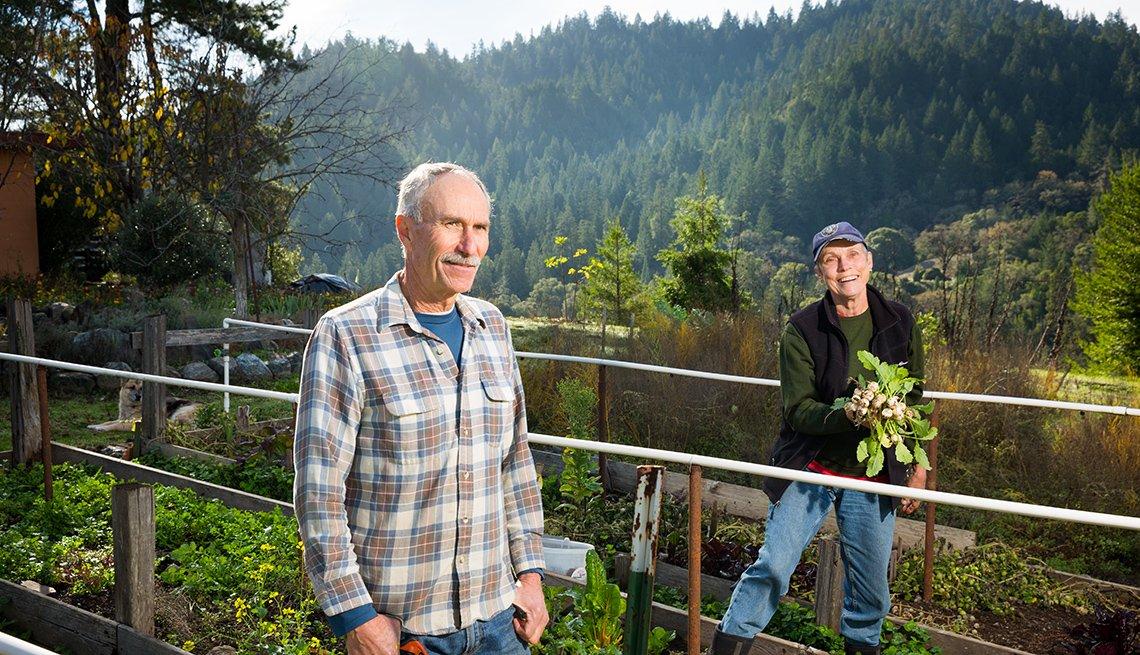 Organic Famers Nikki Ausschnitt and Steve Krieg in their garden