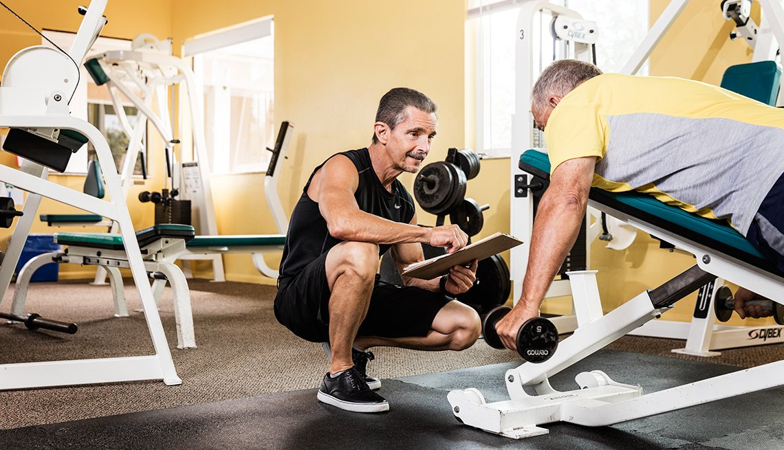 Personal Trainer Tony DiCosta works with a client at a gym