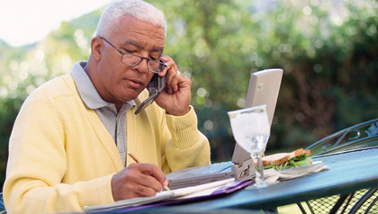 Older man on phone and computer