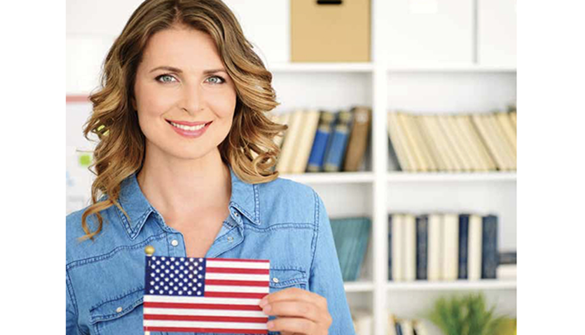 Woman holding an American flag.