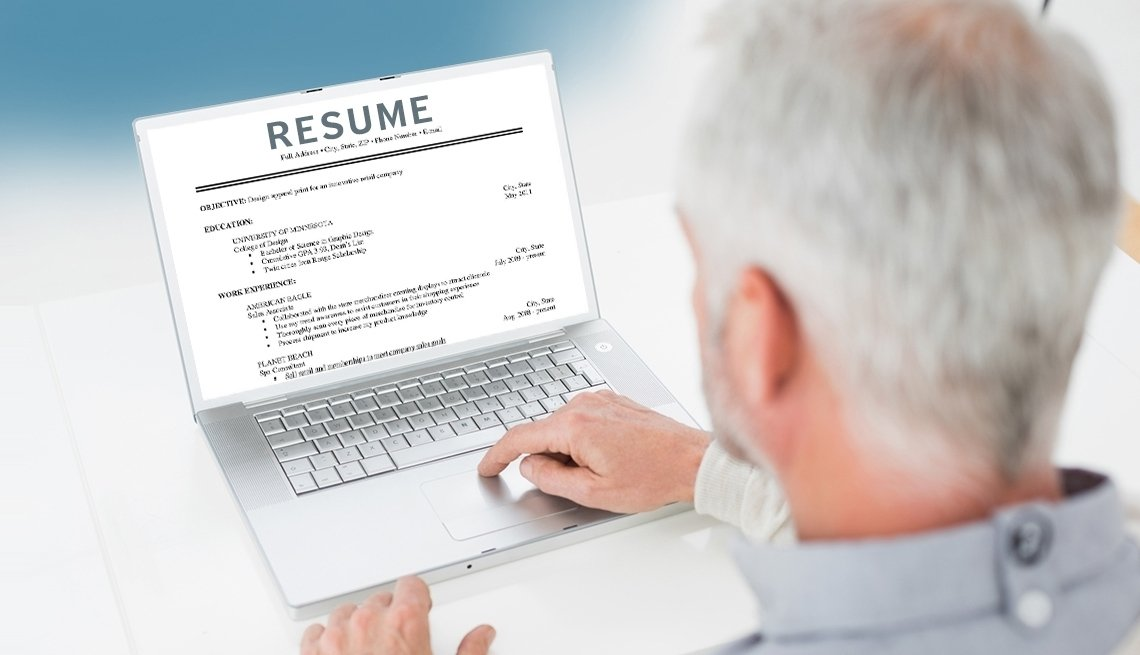 Man sitting at a computer working on his resume