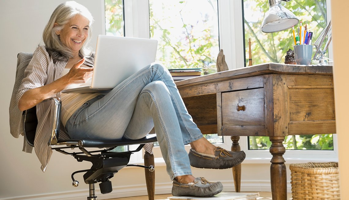 Woman sitting at her desk while working from home
