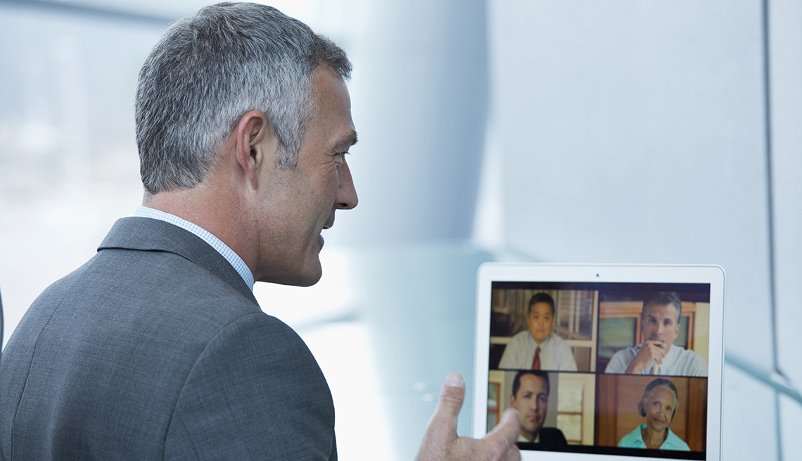A man talking to people on a computer screen