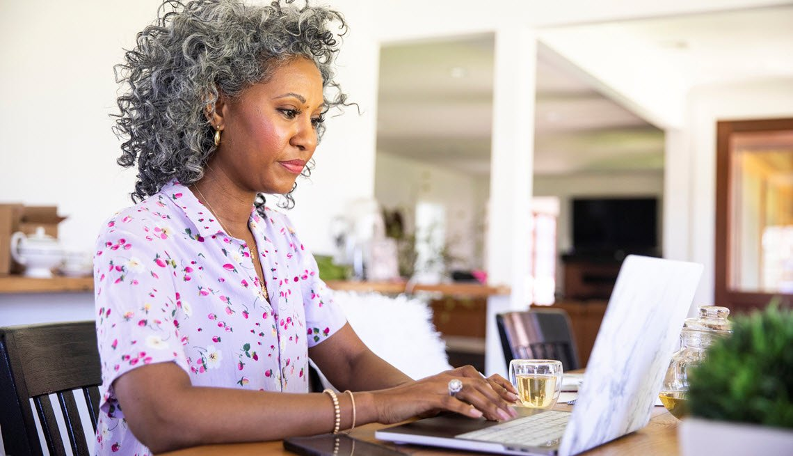 Woman on a laptop at home looking for work