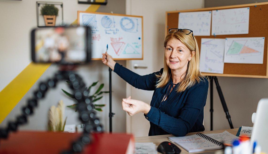 A woman is teaching an online class