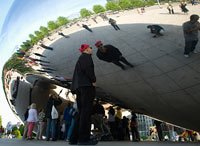 "People crowd around Anish Kapoor's ""Cloud Gate"" in Chicago's Millenium Park."