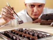 A chef makes chocolates