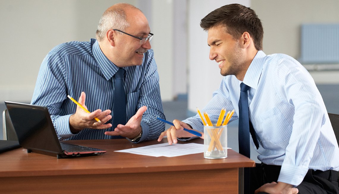 two businessman with laptop, office as background