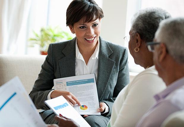 Elderly couple receiving financial consultation, Growing Jobs 2014