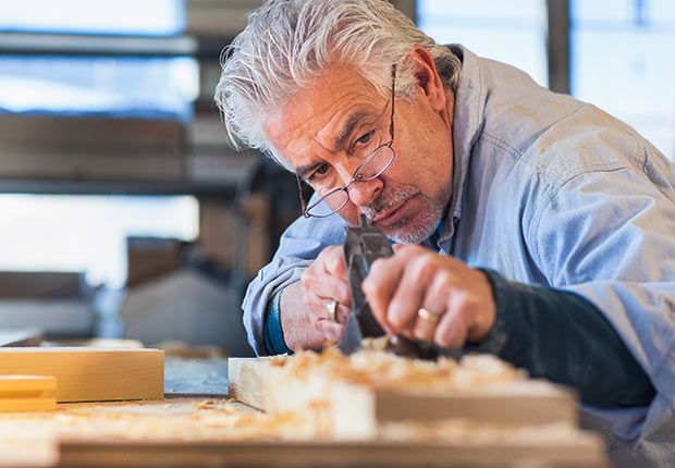 Hispanic wood craftsman working in workshop, Growing Jobs 2014