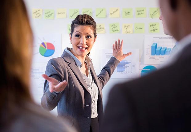 Businesswoman talking in meeting, Growing Jobs 2014