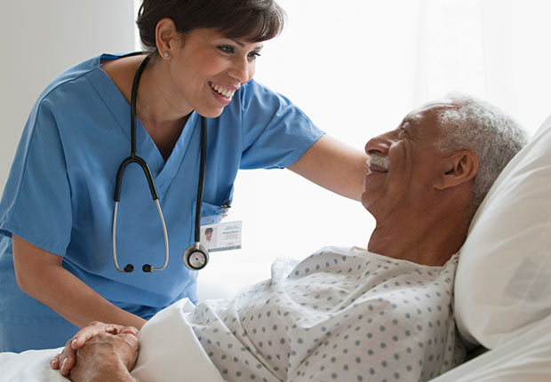 Nurse with elderly male patient, Growing Jobs 2014