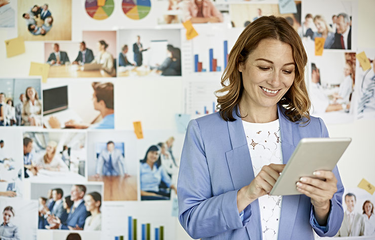 Businesswoman looking at digital tablet, The Basics of Starting Your Own Business