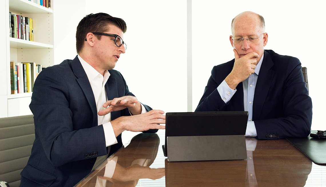 Senior Director at Burson-Marsteller Patrick Kerley give social media advice to CEO Don Baer on Tuesday, January 28, 2015 at the company Washington, DC headquarters.