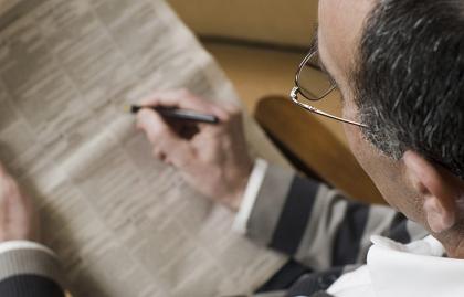 man looking for job in newspaper, Quiz: Understanding Job Listings