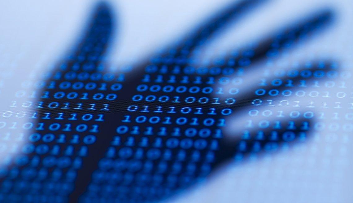 Sombra de una mano sobre un código binario - Tu identidad digital ayuda en tu búsqueda de trabajo