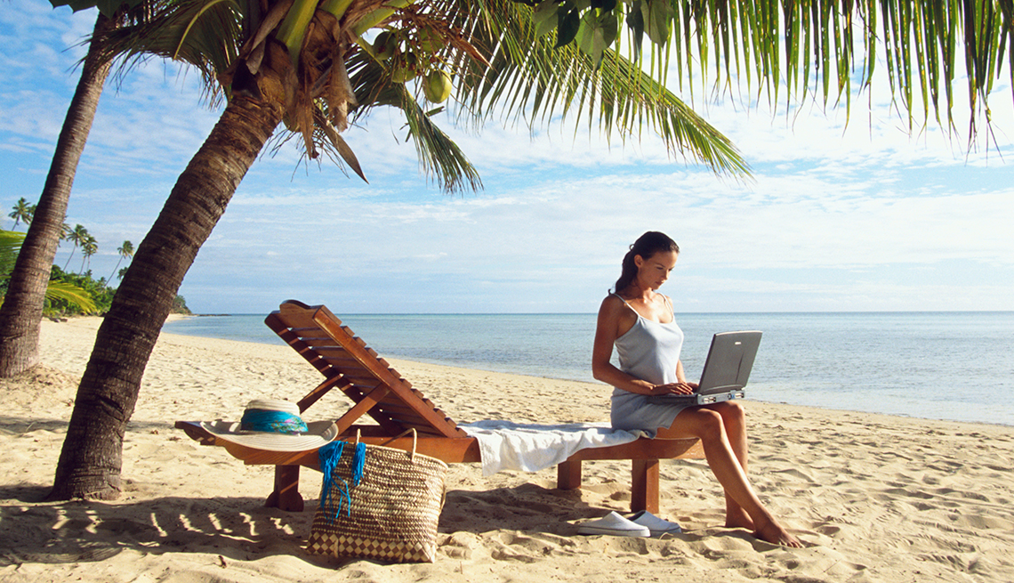 a woman continues her job search during her summer vacation