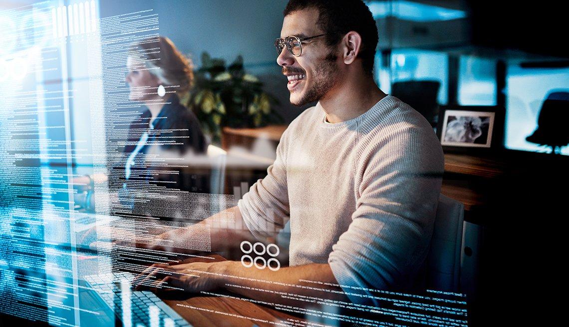 Hombre frente a una computadora y un efecto de luz en una esquina