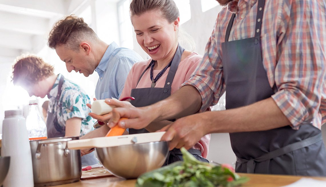 people laugh during a cooking class