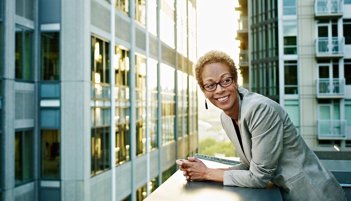Mature woman happy at work