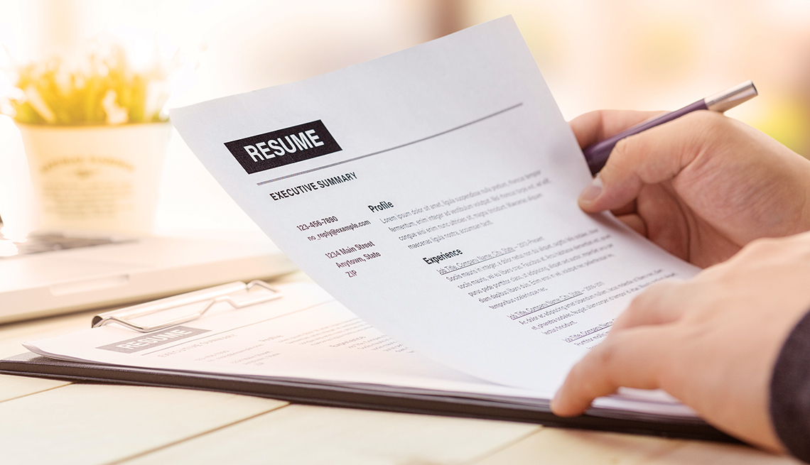 hands holding a resume