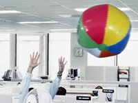 Employees with beachball in the office lose vacation time often out of fear for their jobs
